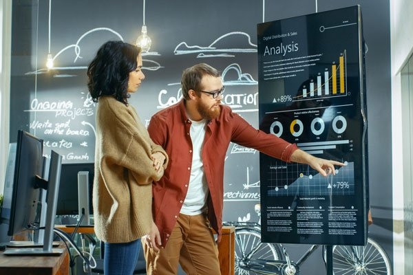 Man and woman collaborating in a smart building